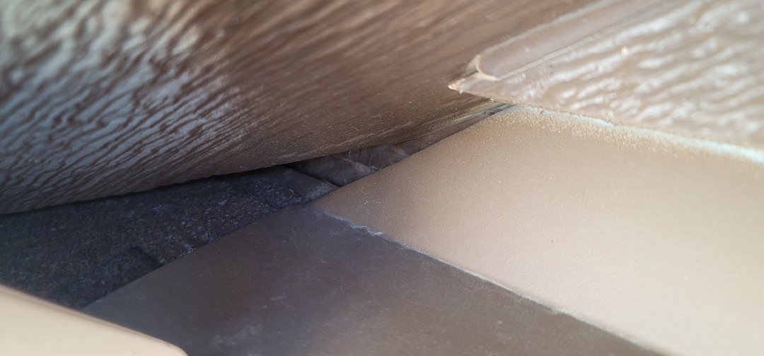 Aurora, CO - We are doing a roof inspection for a roof leak for this house in Aurora that has some flashing issues at the corner of the roof that was not installed properly when the house was built allowing water to penetrate into the attic space during heavy winds and snow