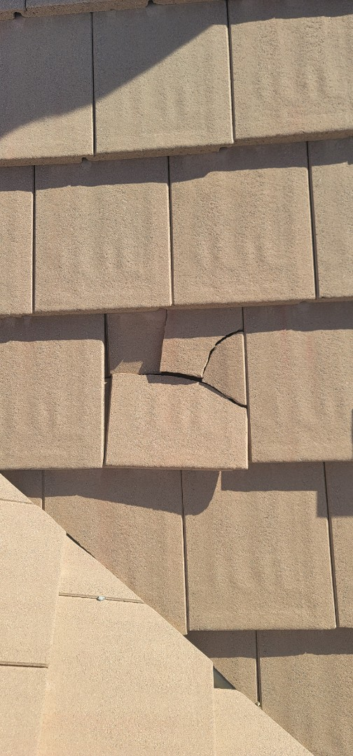 Centennial, CO - We are doing a roof repair for this concrete tile roof in Centennial that has some broken roof tiles