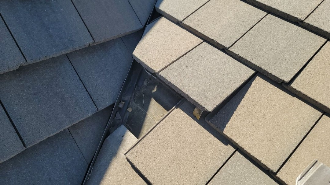 Littleton, CO - We are doing a tile repair for this concrete tile roof in Highlands Ranch