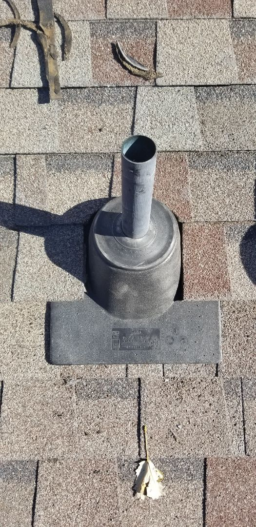 Arvada, CO - Roof repair, remove and replace pipe flashings and collar on furnace flue