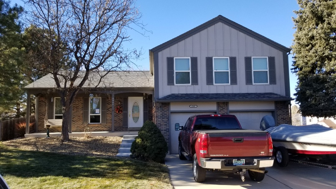 Parker, CO - Replaced roof with a class 4 impact resistant shingle, Owens Corning Duration Storm, estate gray color with new ridge vent and gutters