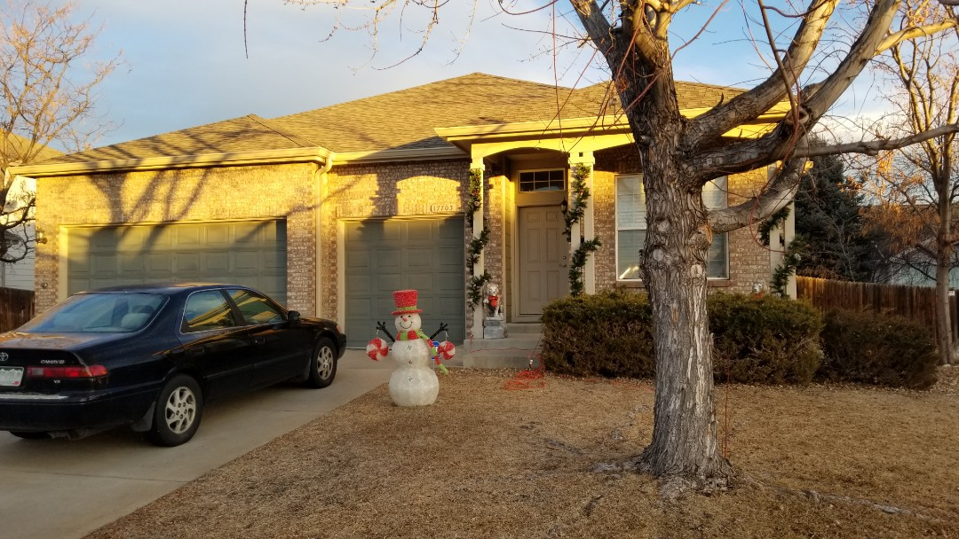 """Parker, CO - We finished up with a roof replacement due to an insurance claim from hail. We also replaced gutters and downspouts with new prepainted 6"""" aluminum gutters."""