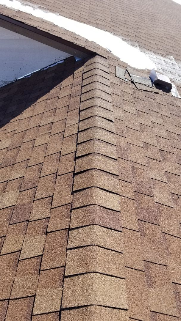 Larkspur, CO - We finished up a roof repair where some ridge shingles were installed incorrectly, replaced a kickout flashing and sealed around some roof vents