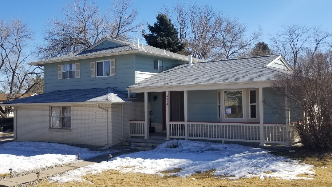 Parker, CO - We did a full roof replacement on this house due to a hail storm last summer. We removed the old roof and installed new TAMKO Heritage asphalt shingles in Arctic White color. We upgraded the ventilation to ridge vent and installed new ice and water shield underlayment at the eaves and valleys. This new roof comes with our no-leak 5 year warranty.