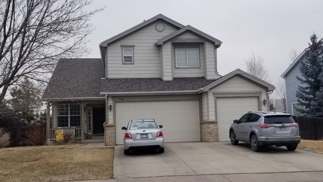 Parker, CO - We did a full roof replacement on this house in Parker with new gutters. We installed new shingles and felt and flashing and roof vents.