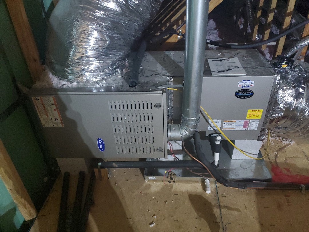 Ooltewah, TN - Service call.  Performed maintenance and installed air purification system on Carrier gas furnace.