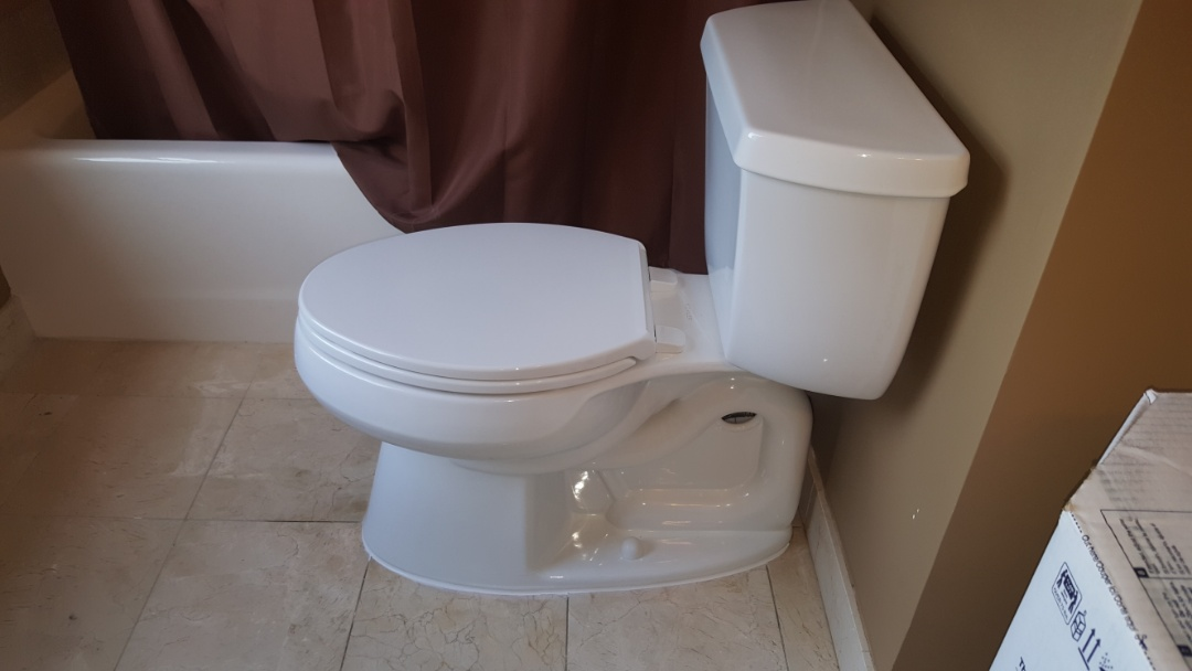 Cartersville, GA - Installing new Kohler elongated comfort height water efficient toilet, and replaced toilet flange