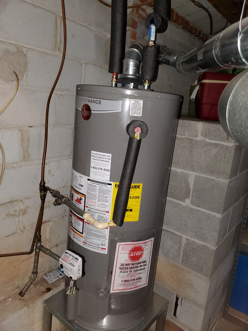 Installed 40 gallon natural gas water heater and new thermal expansion tank with a new water heater stand.