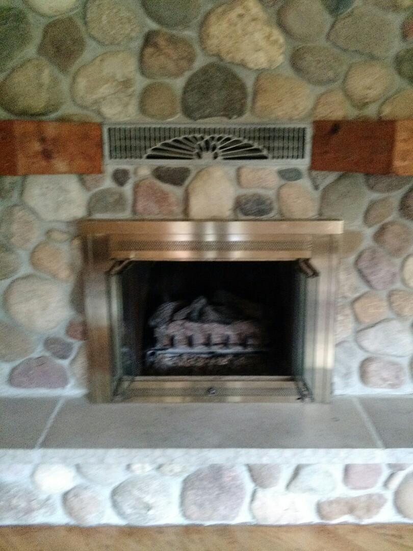 Oconomowoc, WI - Gas Log Fireplace Service.