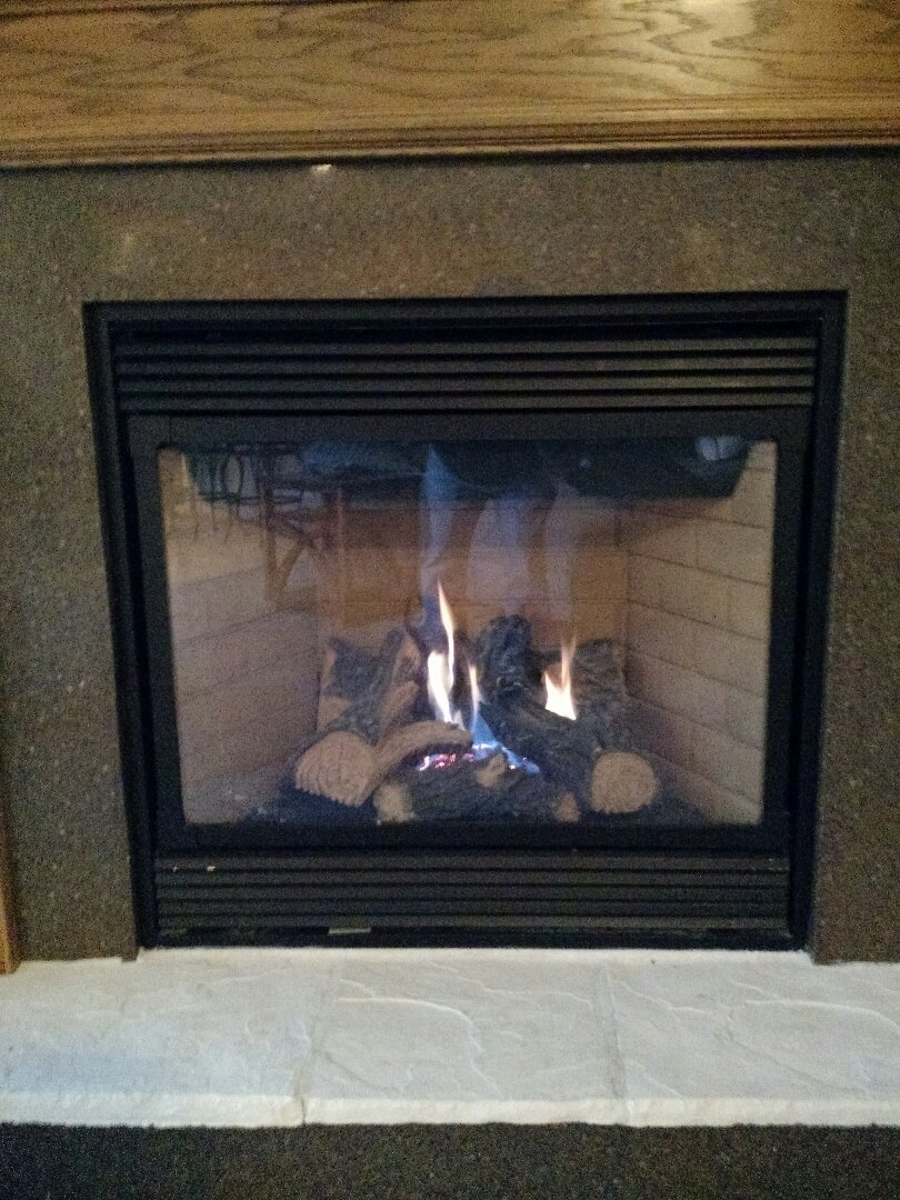 Install blower in fireplace.