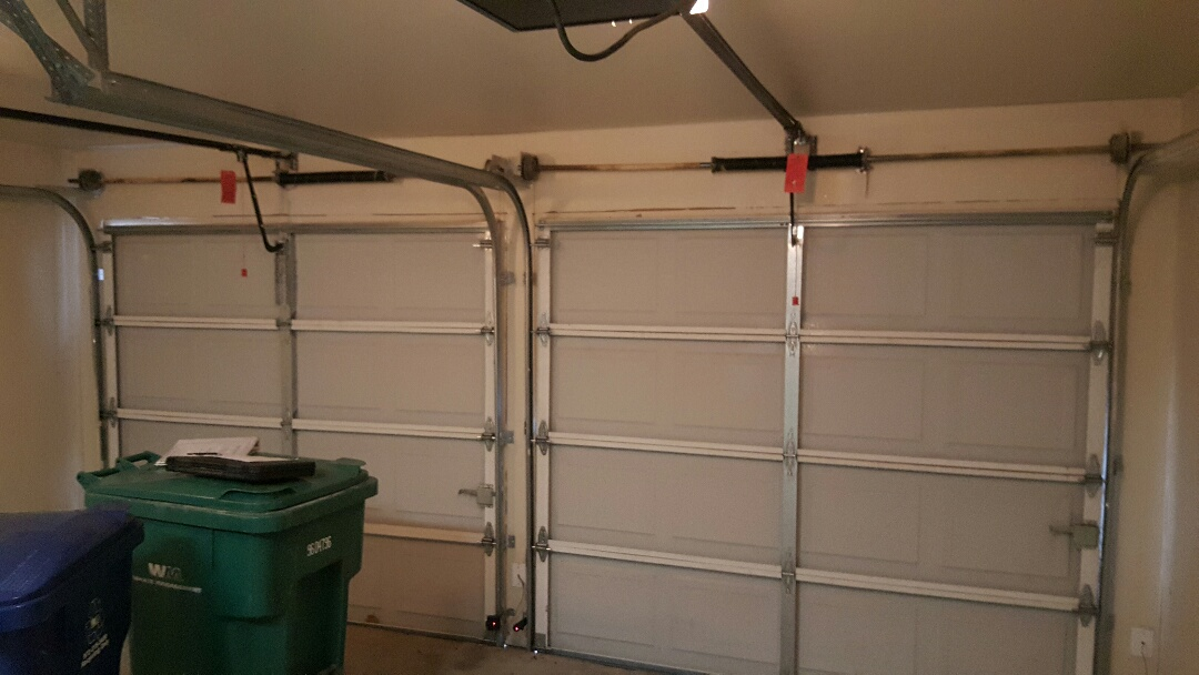 complete 8x7 garage door overhauls one set of Genie safety beams to 375lm UT LiftMaster remotes