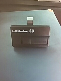 Dallas, TX - Action garage doors new liftmaster remote and program for customer