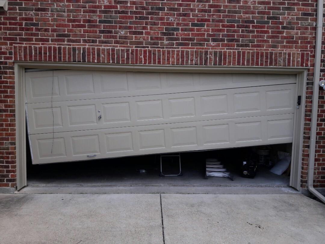 Murphy, TX - Garage door problem door off track. Repaired new track and rollers
