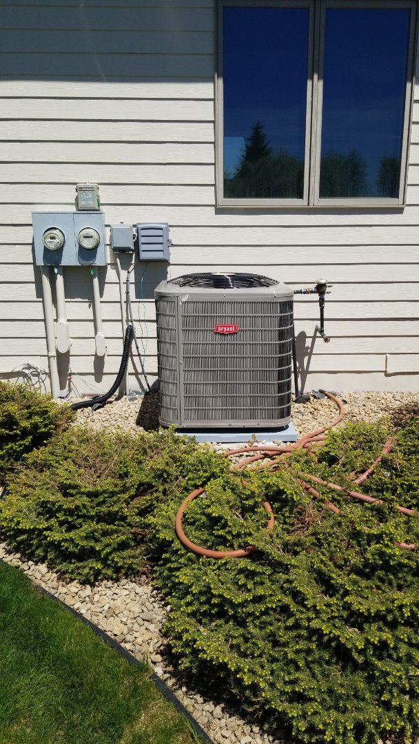 Maple Plain, MN - Leveling Bryant Air Conditioner that was set in winter in Maple Plain