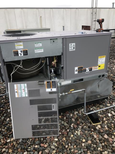 Edina, MN - Performing commercial rooftop maintenance and filter change in Edina Minnesota