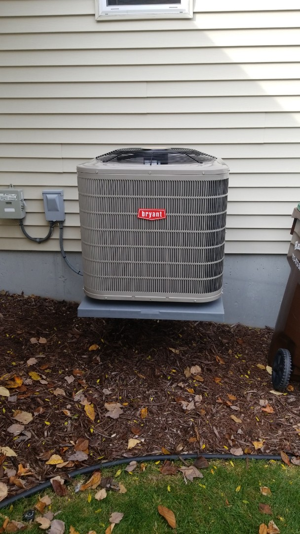 Maple Grove, MN - Installing Bryant air conditioner in Maple Grove Minnesota