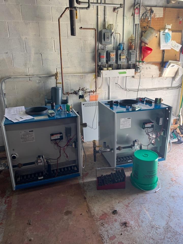 Install 2 new slant fin boilers in Delano MN