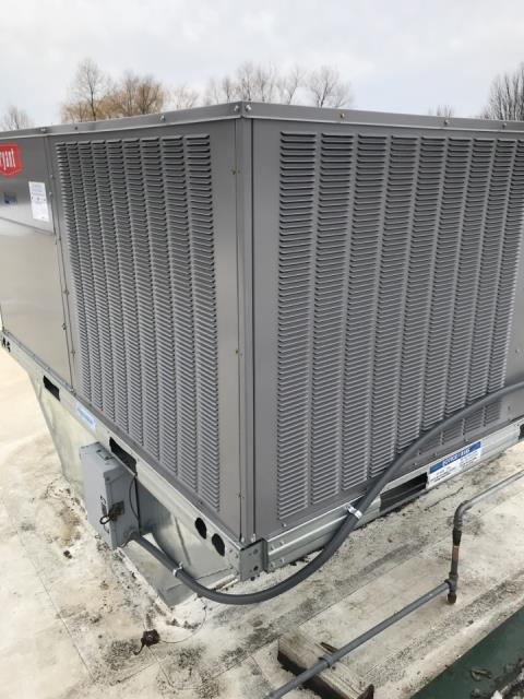 Medina, MN - Installed hail guards on a roof top unit on top of a business in loretto, MN!