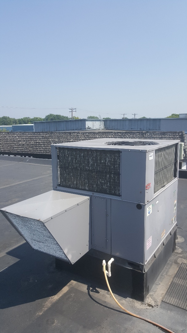 Winsted, MN - Changing air filters on Bryant rooftop units in Winsted