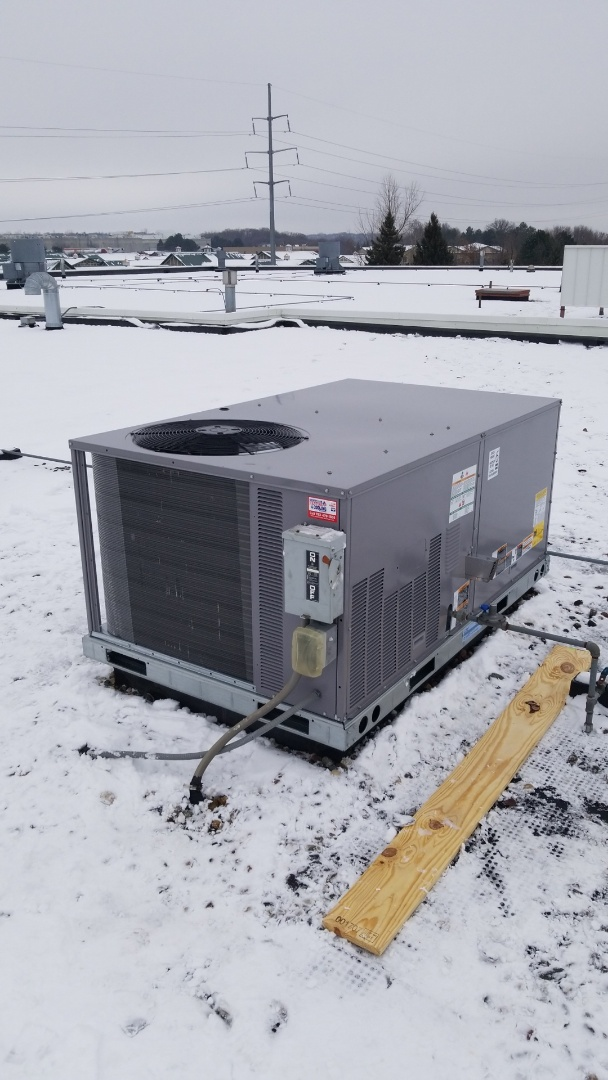 Chanhassen, MN - Installing new Bryant rooftop unit in Chanhassen