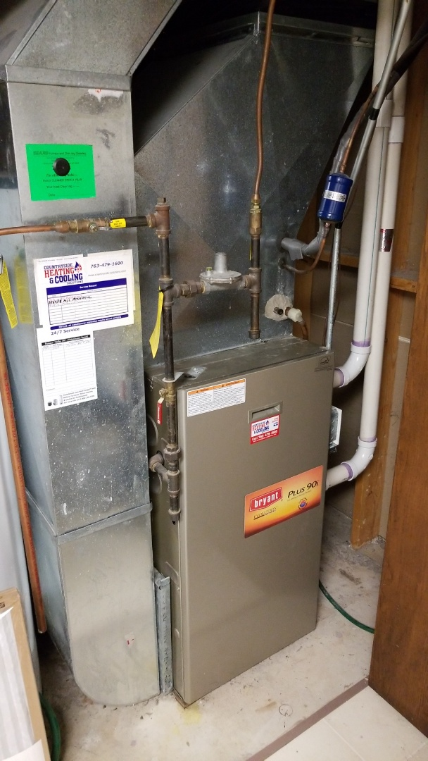 Minneapolis, MN - Installing ductwork and thermostat on Bryant Evolution system in Plymouth