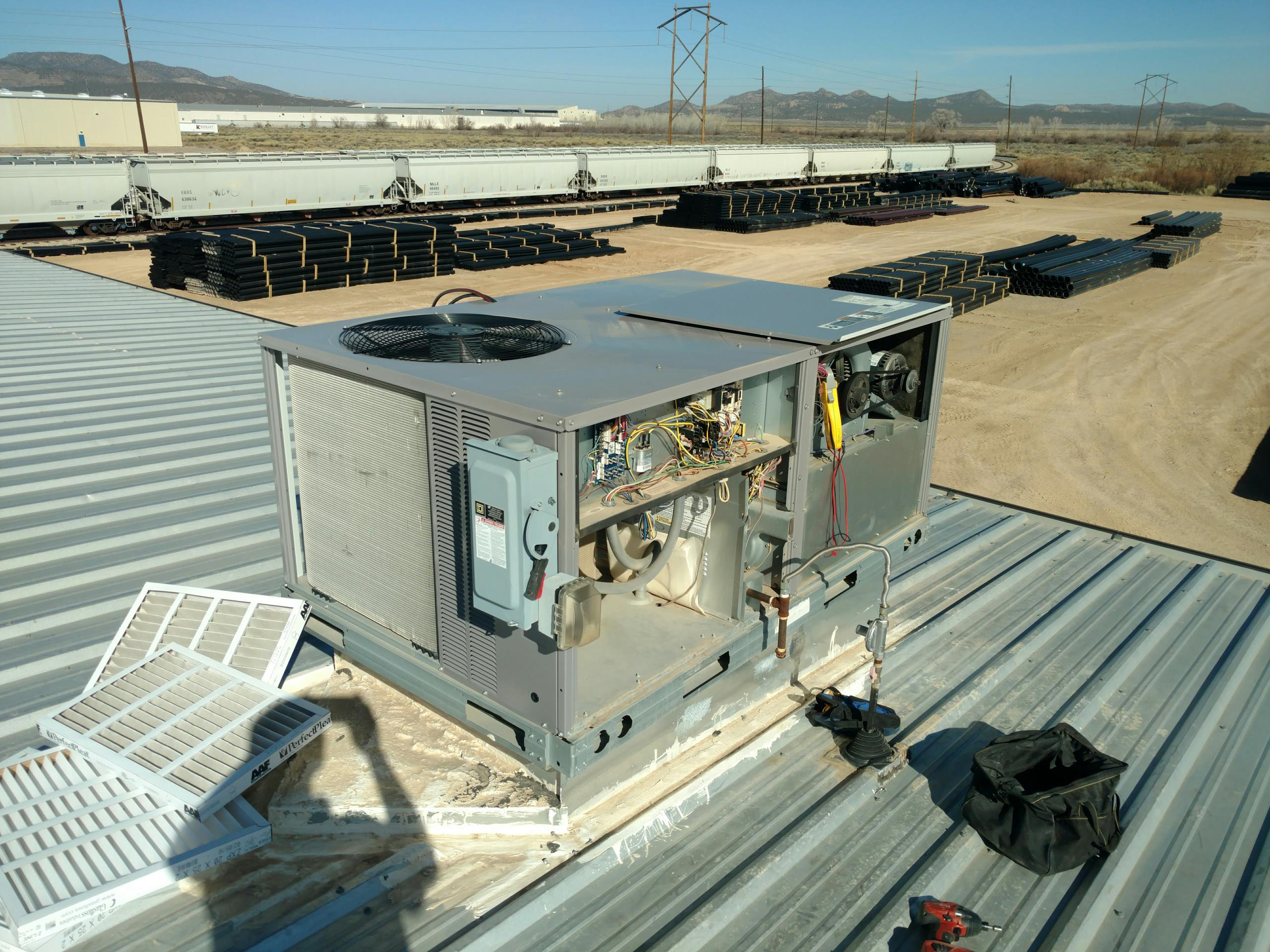 Cedar City, UT - Dixie Heating and Air Conditioning performing summer maintenance check on Carrier gas package unit AC