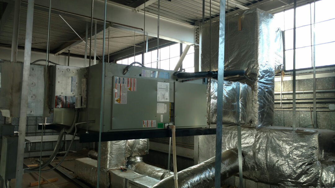 Page, AZ - Dixie Heating and Air Conditioning installing new Trane Air Handler above warehouse mezzanine