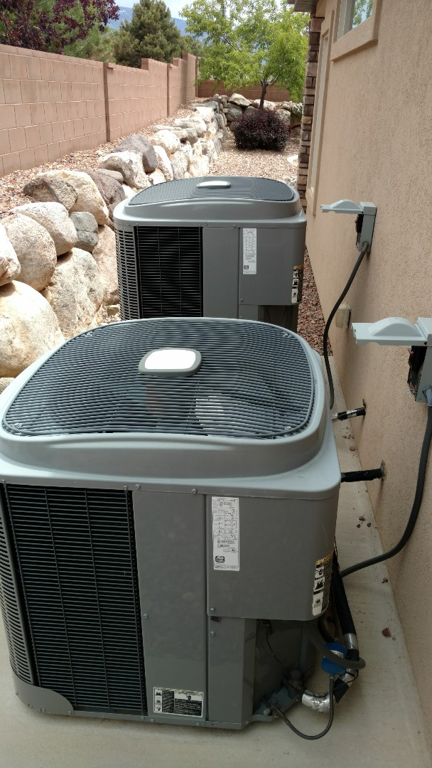 Cedar City, UT - Dixie Heating and Air Conditioning performing summer preventative maintenance on two Tempstar AC split systems
