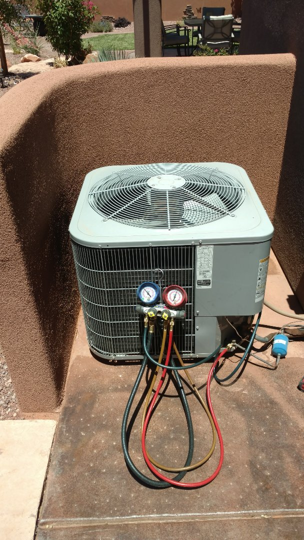 Ivins, UT - Dixie Heating and Air Conditioning replacing bad dual capacitor on Carrier AC split system