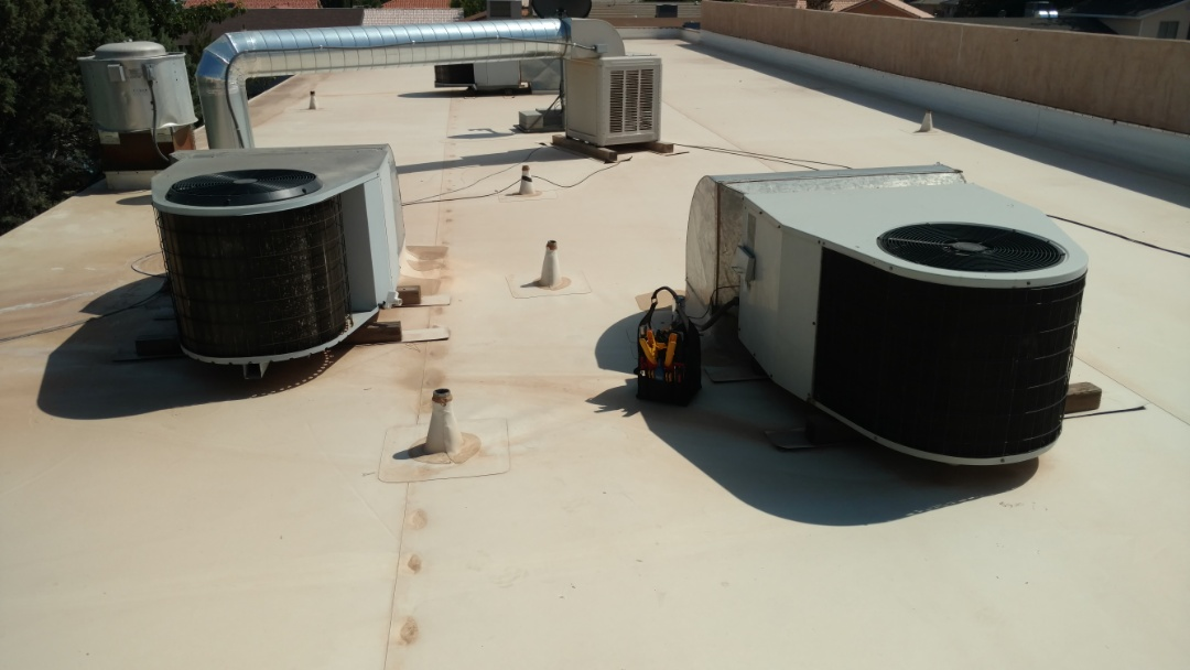 Ivins, UT - Dixie Heating and Air Conditioning replacing bad dual capacitor and cleaning coils on HEIL rooftop package heat pumps