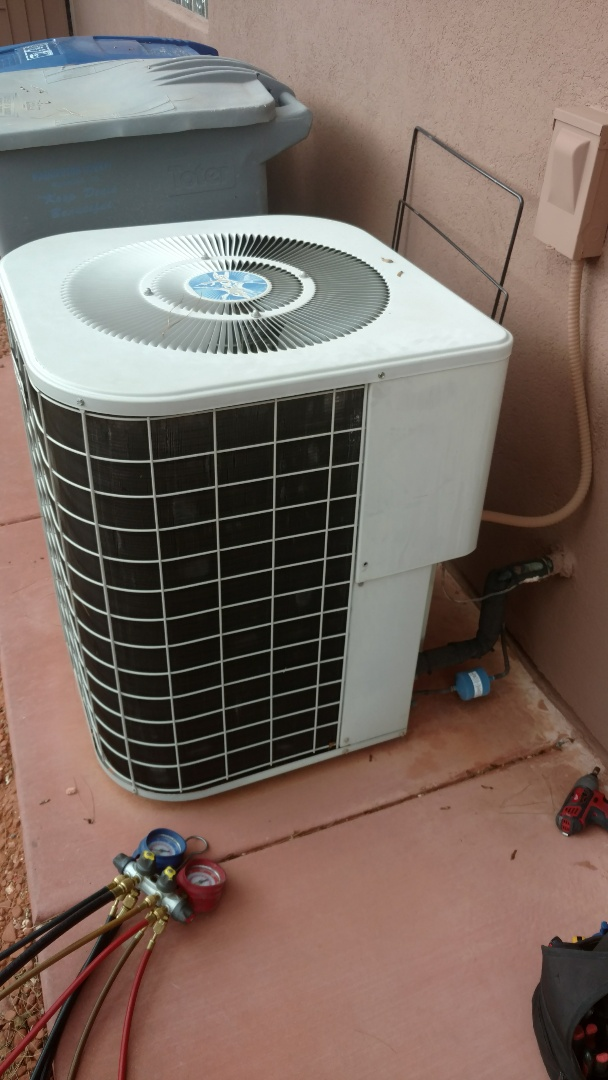 Ivins, UT - Dixie Heating and Air Conditioning replacing bad dual capacitor on Heil AC split system