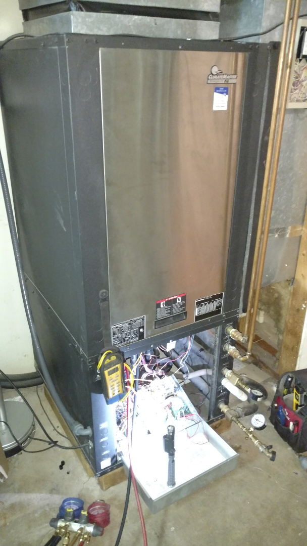 Santa Clara, UT - Dixie Heating and Air Conditioning performing routine maintenance on Climate Master geothermal heat pump
