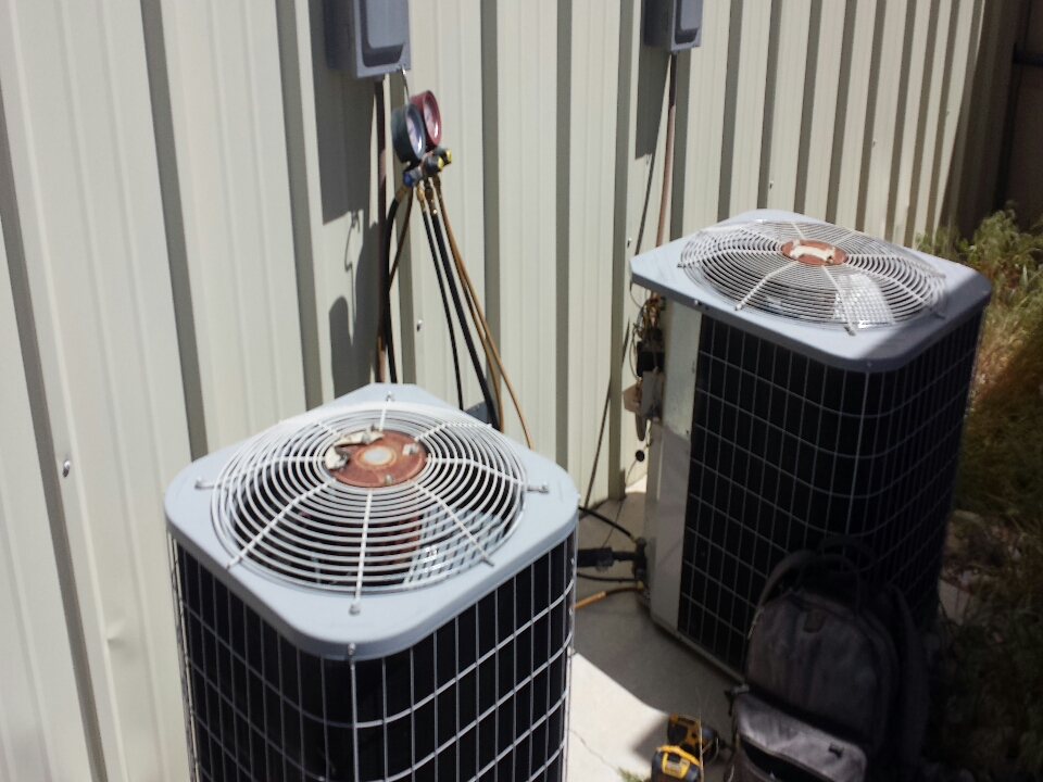 Cedar City, UT - Dixie HVAC performing maintenance inspection on two carrier split systems
