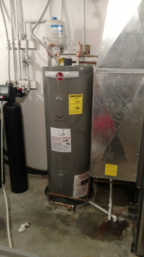 Santa Clara, UT - Dixie Heating and Air Conditioning replacing leaking Rheem electric water heater