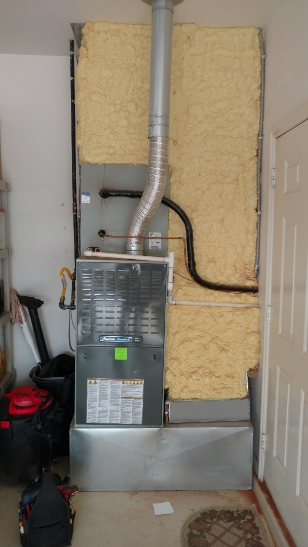 Ivins, UT - Dixie Heating and Air Conditioning performing routine maintenance on American Standard gas furnace
