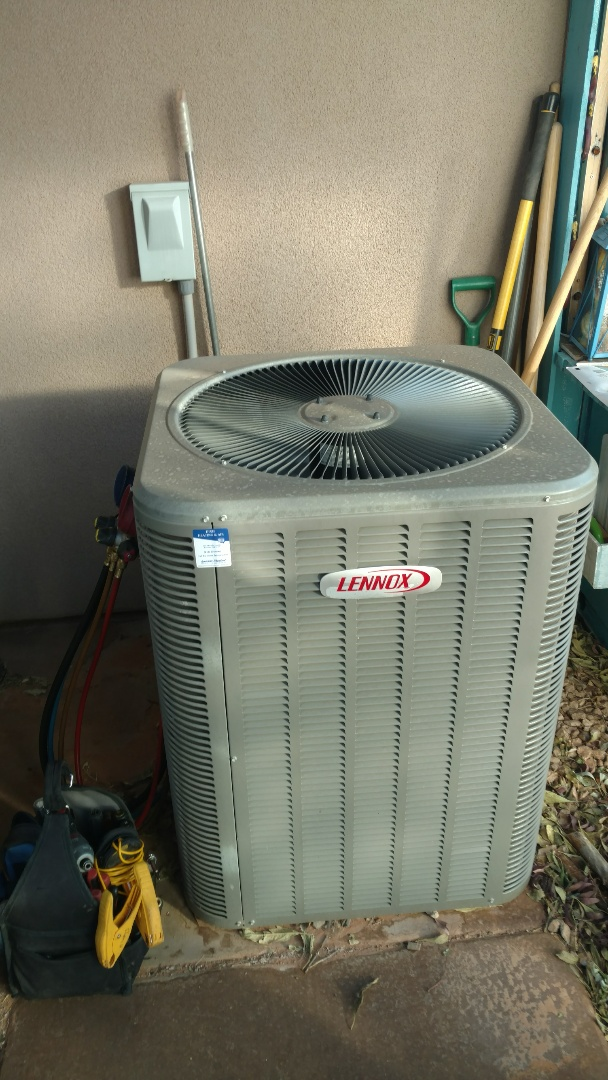 Hurricane, UT - Dixie Heating and Air Conditioning performing routine maintenance on two Lennox heat pump systems