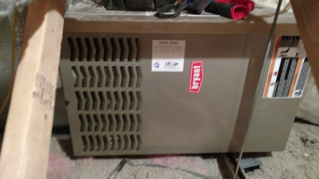 Washington, UT - Dixie Heating and Air Conditioning performing routine maintenance on Bryant gas furnace