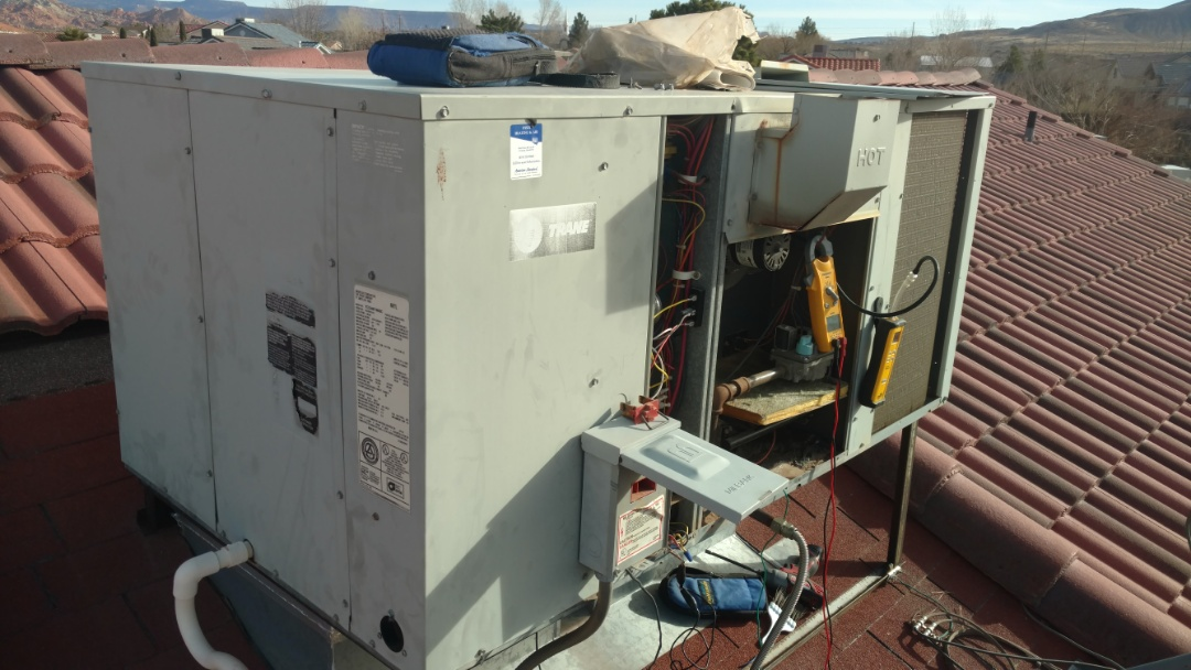 Hurricane, UT - Dixie Heating and Air Conditioning performing routine maintenance and replacing capacitor and contactor on Trane package gas unit