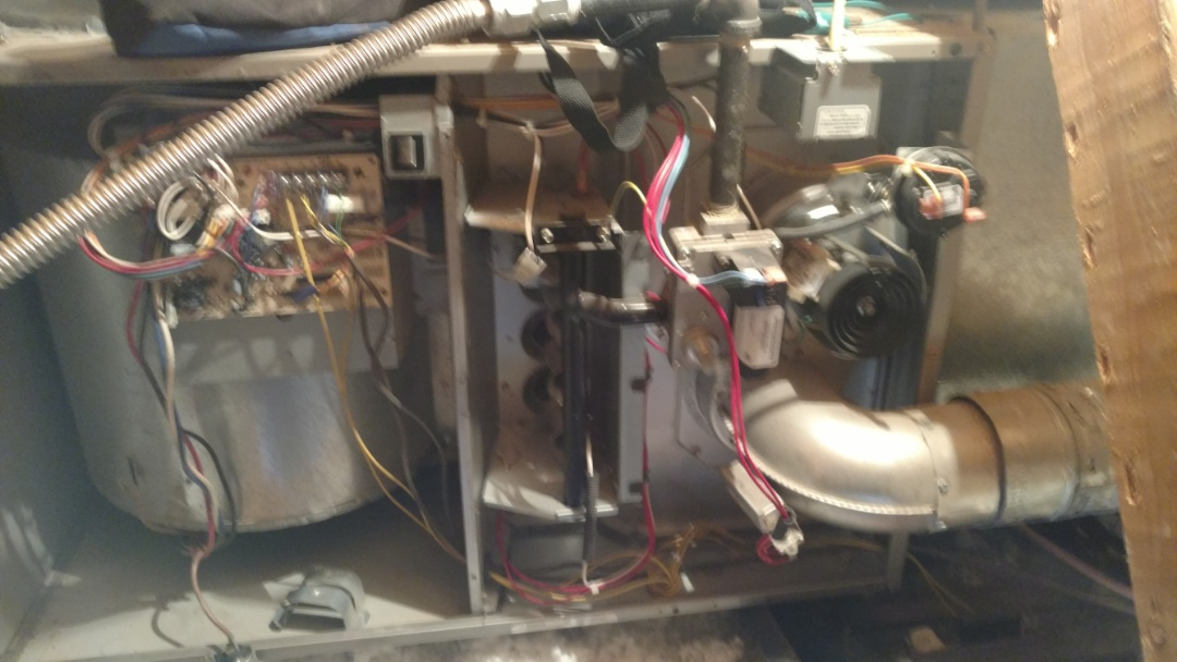 Washington, UT - Dixie Heating and Air Conditioning inspecting Bryant gas furnace