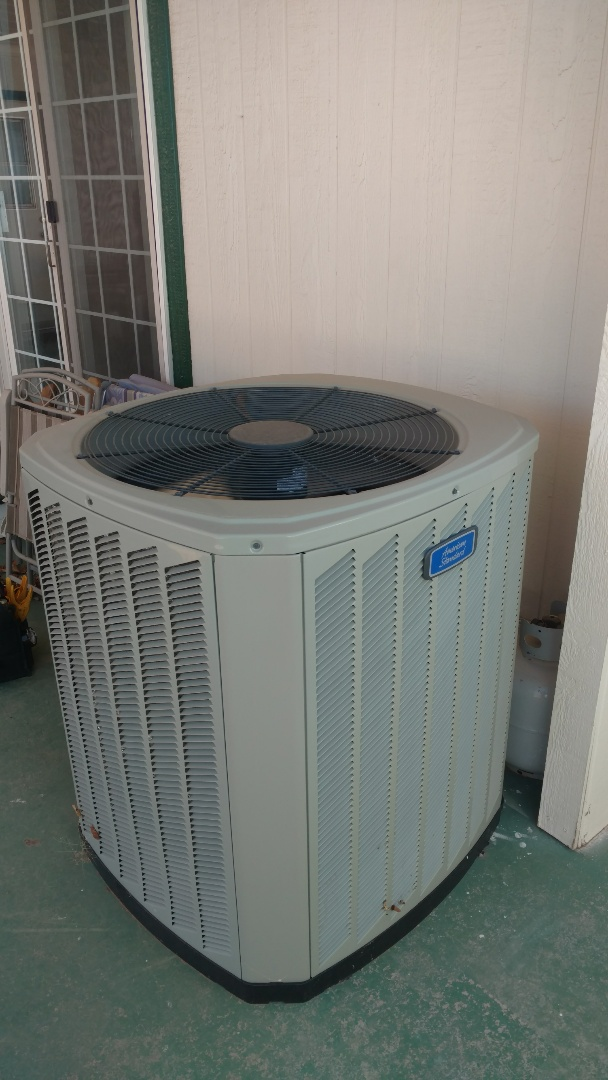 Hurricane, UT - Dixie Heating and Air Conditioning performing routine maintenance on American Standard AC