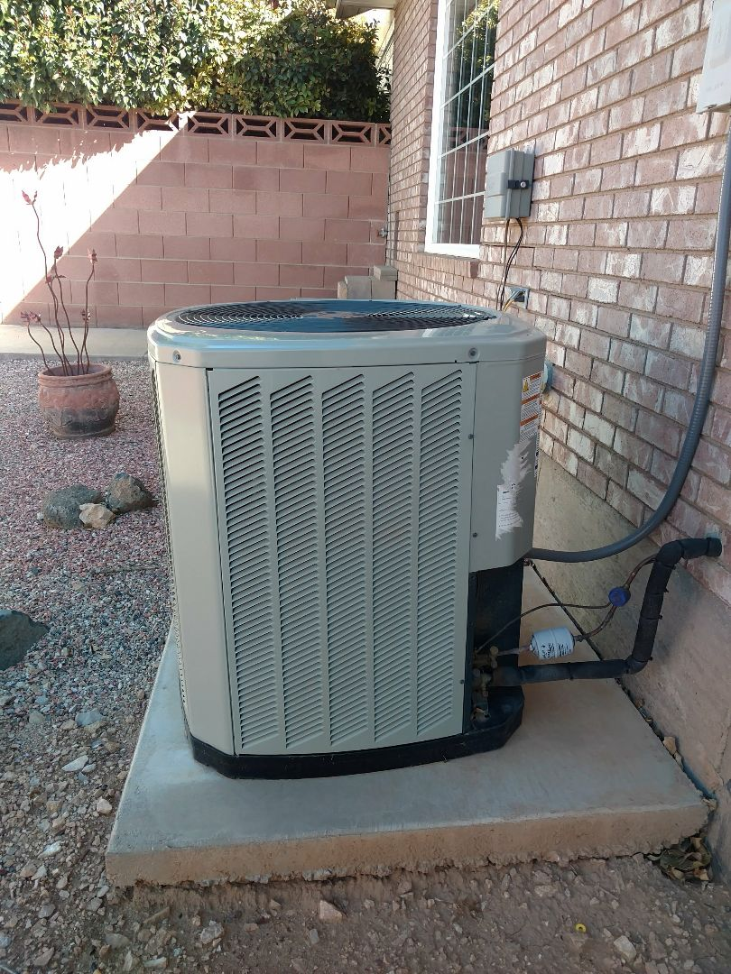 Hurricane, UT - Dixie Heating and Air Conditioning performing routine maintenance on American Standard AC split system