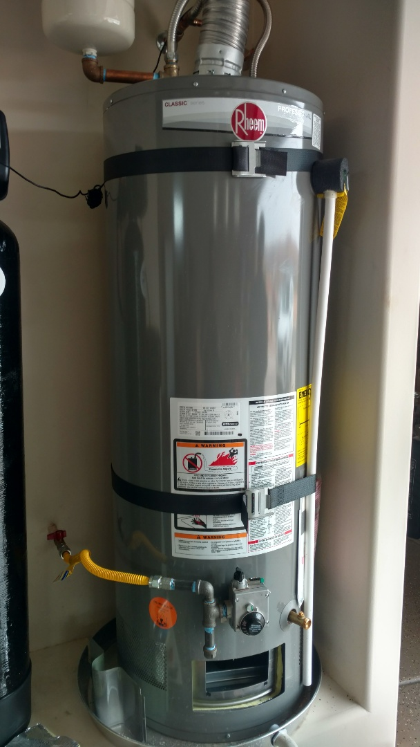Washington, UT - Dixie Heating and Air Conditioning replacing bad ignitor and pilot assembly on Rheem water heater