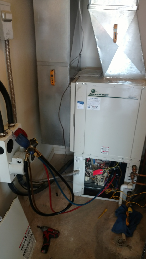 Ivins, UT - Dixie Heating and Air Conditioning performing routine maintenance on Climate Master Geothermal heat pump