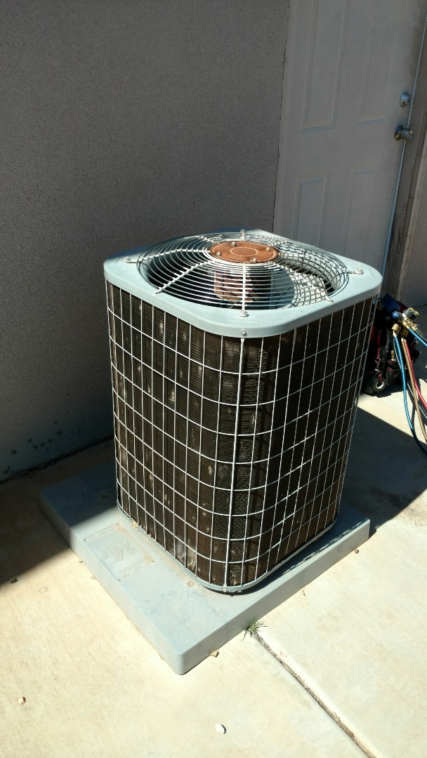 Washington, UT - Dixie Heating and Air Conditioning performing routine maintenance on Carrier AC split system