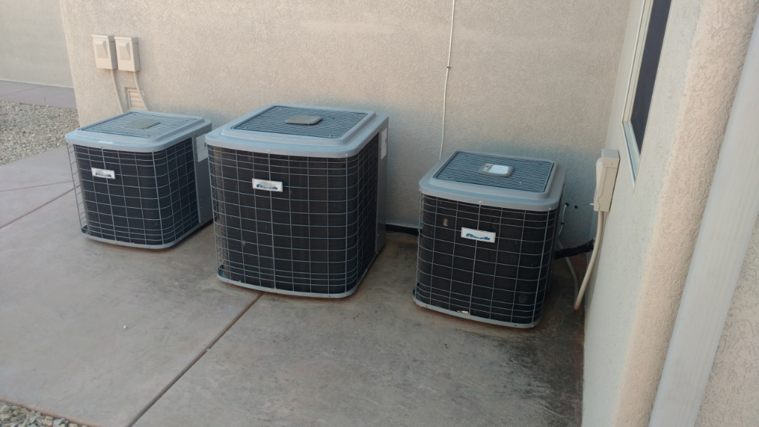 Washington, UT - Dixie Heating and Air Conditioning performing routine maintenance on three Heil AC split systems