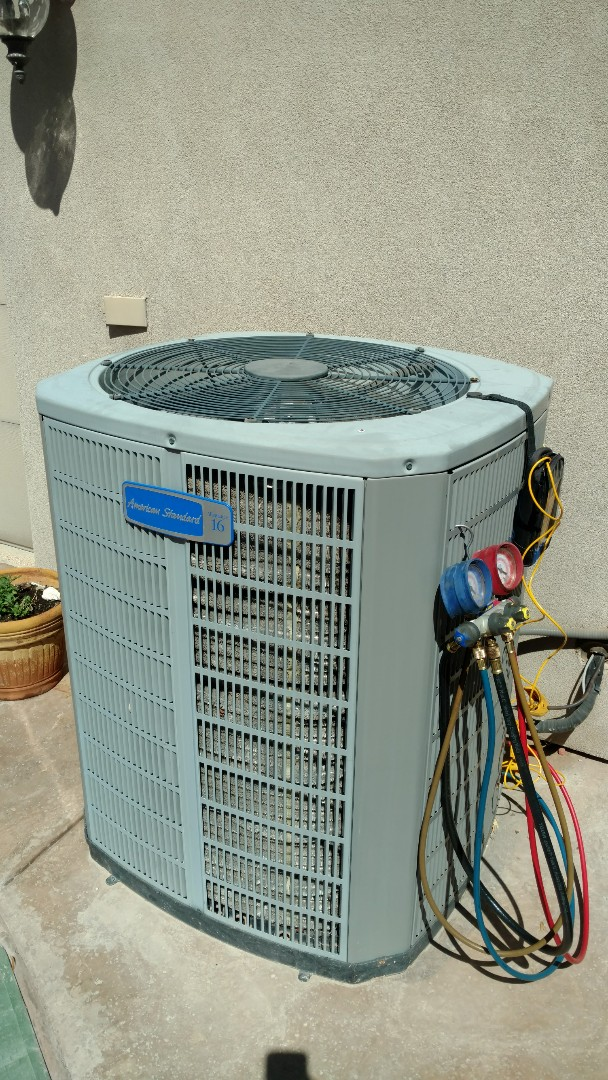Washington, UT - Dixie Heating and Air Conditioning performing routine maintenance on American Standard AC split system