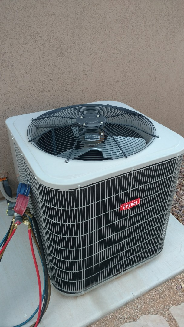 Santa Clara, UT - Dixie Heating and Air Conditioning performing routine maintenance on Bryant AC split system