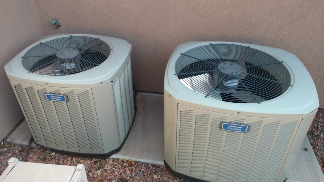 Washington, UT - Dixie Heating and Air Conditioning performing routine maintenance on two American Standard AC split system and replacing warranty condensor fan motor