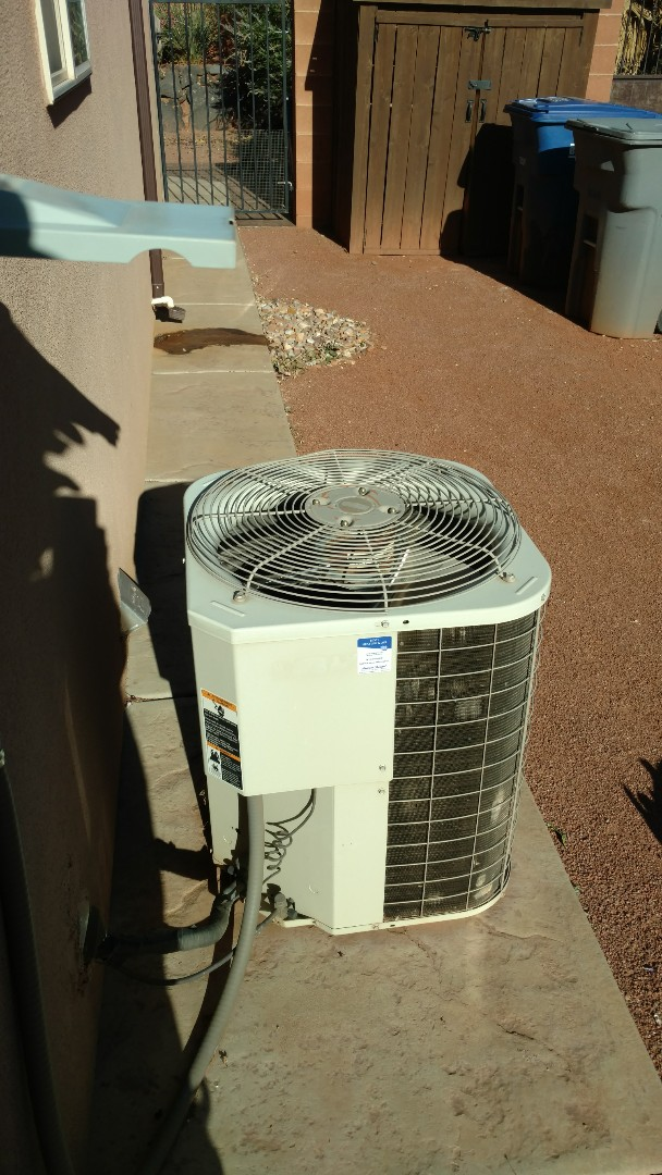 Ivins, UT - Dixie Heating and Air Conditioning performing routine maintenance on Bryant AC split system