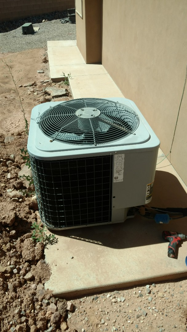 Washington, UT - Dixie Heating and Air Conditioning diagnosing airflow problems and adding puron refrigerant on Day and Night dual fuel system